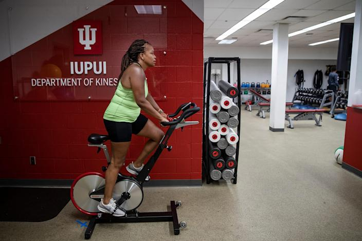 NiCole Keith, president of the American College of Sports Medicine, rides a stationary bike during a workout on Monday, July 13, 2020, at the IUPUI Natatorium in Indianapolis, Ind.