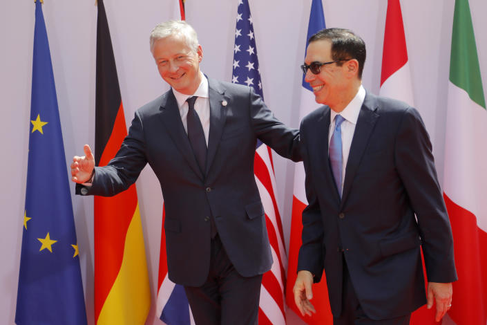 French Finance Minister Bruno Le Maire, left, welcomes Treasury Secretary Steve Mnuchin at the G-7 Finance Wednesday July 17, 2019 in Chantilly, north of Paris. The Group of Seven rich democracies' top finance officials gathered Wednesday at a chateau near Paris in search of common ground on the threats posed by digital currencies. (AP Photo/Michel Euler)