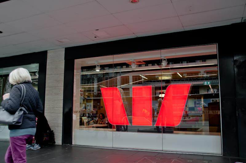 Melbourne, Australia - July 26, 2018: Aged woman walks in front of Westpac bank in Melbourne Australia
