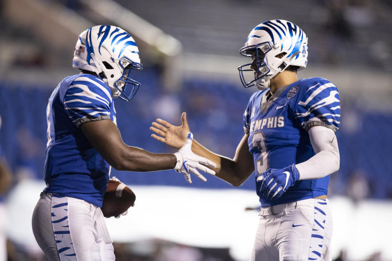 Brady White, right, made some nice throws in the opener, including a pretty TD pass to Sean Dykes, left, against Arkansas State. (Photo by Brett Carlsen/Getty Images)