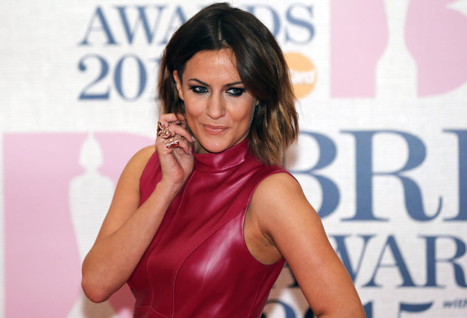 Television presenter Caroline Flack arrives for the BRIT music awards at the O2 Arena in Greenwich, London, February 25, 2015. REUTERS/Suzanne Plunkett (BRITAIN - Tags: ENTERTAINMENT)