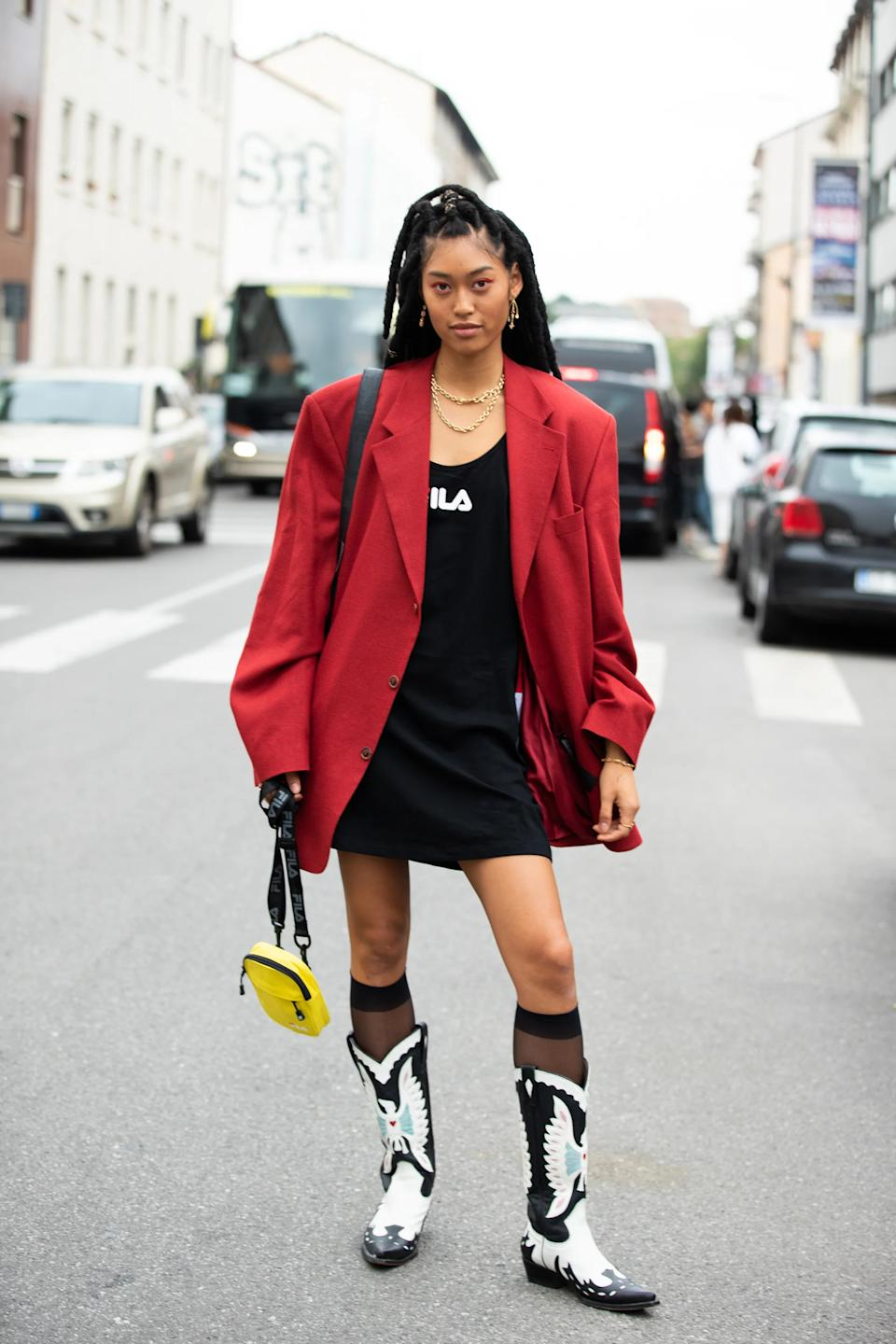 """From the boots to the blazer to the sporty mini dress — there's nothing about this look that we <em>don't</em> want to buy this season.<span class=""""copyright""""> Photographed by Melodie Jeng.</span>"""