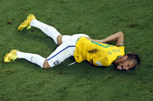 Brazil's Neymar grimaces in pain during the World Cup quarterfinal soccer match between Brazil and Colombia at the Arena Castelao in Fortaleza, Brazil, Friday, July 4, 2014. Brazil's team doctor says Neymar will miss the rest of the World Cup after breaking a vertebrae during the team's quarterfinal win over Colombia. (AP Photo/Fabrizio Bensch, Pool)