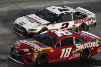 Kyle Busch (18) and Brad Keselowski (2) drive out of Turn 4 during the NASCAR Cup Series auto race Saturday, Sept. 19, 2020, in Bristol, Tenn. (AP Photo/Steve Helber)