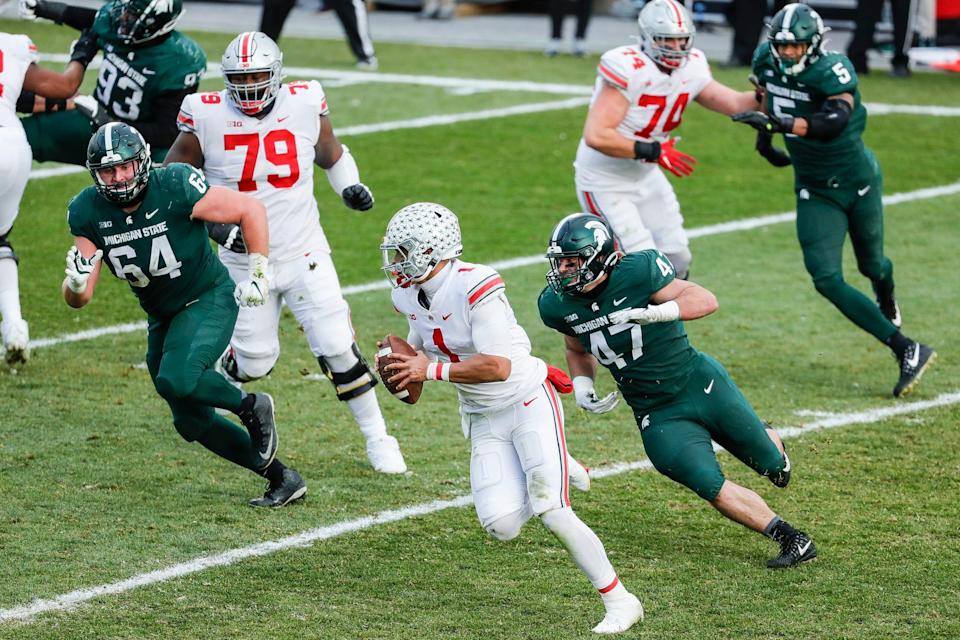 Michigan State defensive end Jeff Pietrowski (47) chases Ohio State quarterback Justin Fields (1) during the second half at the Spartan Stadium in East Lansing on Saturday, Dec. 5, 2020.