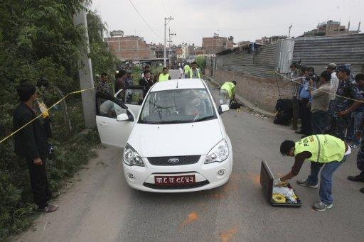 Nepalese crime officers examine the car in which a Supreme Court judge was shot in Kathmandu on Thursday. Gunmen on a motorbike shot and killed the judge, sparking fears of lawlessness amid a political vacuum in the Himalayan country