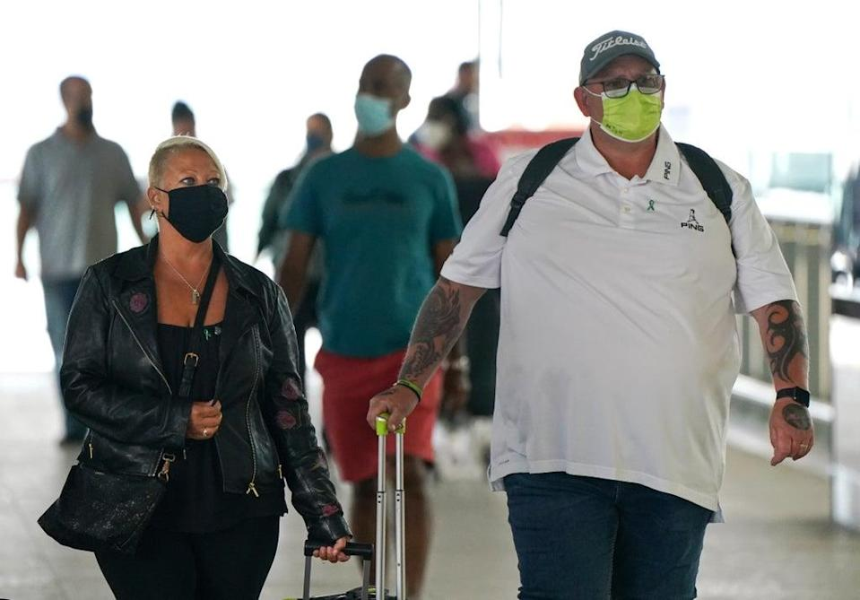 Charlotte Charles (left) and Tim Dunn, the parents of Harry Dunn arrive at Terminal 2 of Heathrow Airport, London, before departing on a flight to the US to give evidence under oath as part of a damages claim against their son???s alleged killer. Picture date: Tuesday June 29, 2021. (PA Wire)