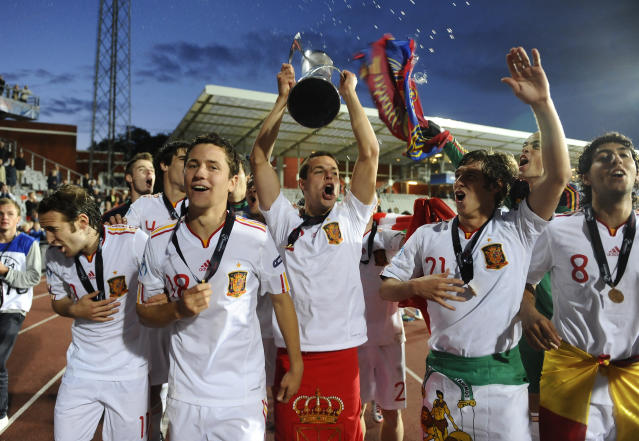 Spain's players celebrates with the trophy at the end of the UEFA Under-21 European Championship final match Spain vs Switzerland at the Aarhus Stadium, on June 25, 2011. Spain win the final with 2-0.AFP PHOTO/CLAUS FISKER/SCANPIX (Photo credit should read CLAUS FISKER/AFP/Getty Images)