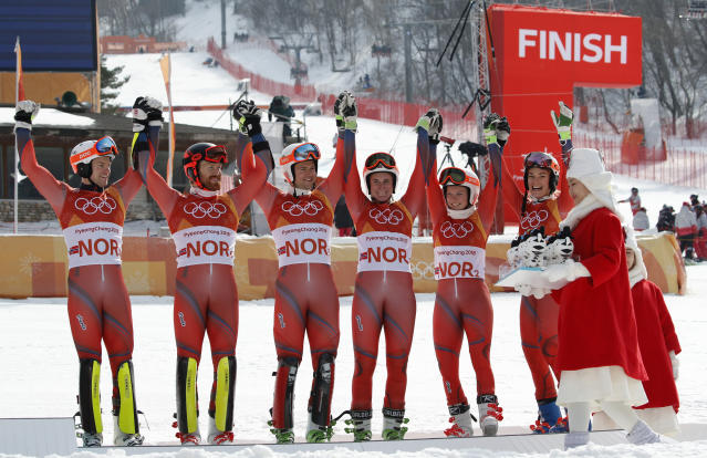 Team Norway celebrates taking the bronze medal in the alpine team event during the venue ceremony at the 2018 Winter Olympics in Pyeongchang, South Korea, Saturday, Feb. 24, 2018. (AP Photo/Christophe Ena)