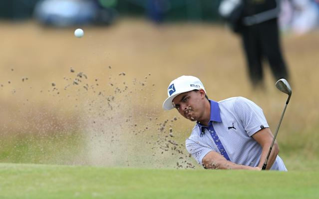 Rickie Fowler of the US plays a shot out of a bunker onto the 18th green during the third day of the British Open Golf championship at the Royal Liverpool golf club, Hoylake, England, Saturday July 19, 2014. (AP Photo/Scott Heppell)