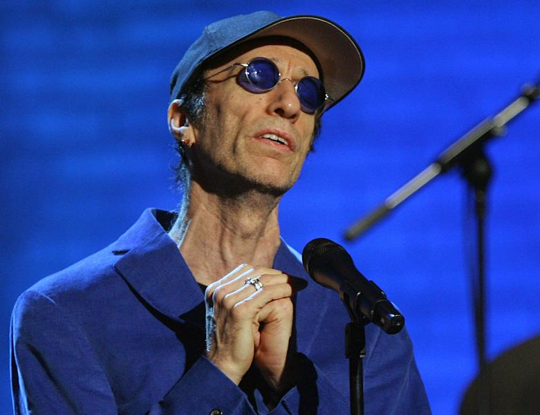 "FILE - Robin Gibb performs during the ""Jose Carreras Gala"" rehearsal in Leipzig, eastern Germany, in this Dec. 14, 2006 file photo. The Sun newspaper reported Saturday April 15, 2012 that 62-year-old Gibb is in a coma, citing a family friend. British media reports say former Bee Gee Robin Gibb is gravely ill with pneumonia in a London hospital. (AP Photo/Eckehard Schulz, File)"