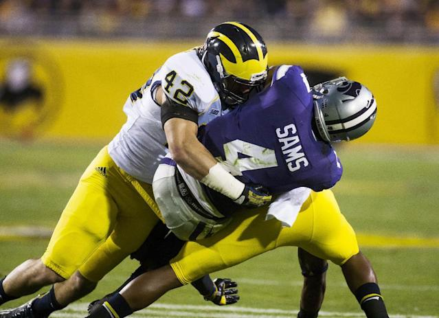 Michigan linebacker Ben Gedeon, left, and a teammate tackle Kansas State quarterback Daniel Sams during the Buffalo Wild Wings Bowl NCAA college football game Saturday, Dec. 28, 2013, in Tempe, Ariz. (AP Photo/The Arizona Republic, Stacie Scott)