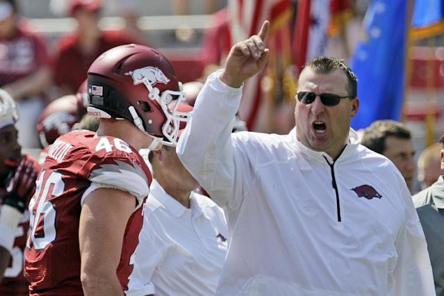 Arkansas coach Bret Bielema, right, shouts to players as tight end Alex Voelzke (46) walks past during warm-ups before an NCAA college football game against Louisiana-Lafayette in Fayetteville, Ark., Saturday, Aug. 31, 2013. (AP Photo/Danny Johnston)
