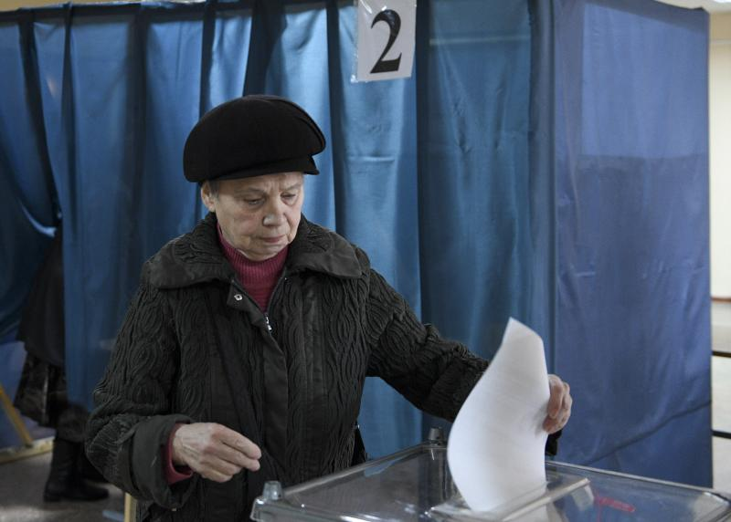 A woman casts her ballot at a polling station during rebel elections in Donetsk, Ukraine, Sunday, Nov. 11, 2018. Residents of the eastern Ukraine regions controlled by Russia-backed separatist rebels are voting for local governments in elections denounced by Kiev and the West. (AP Photo)