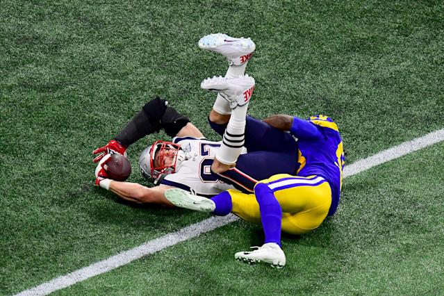 <p>Cory Littleton #58 of the Los Angeles Rams tackles Rob Gronkowski #87 of the New England Patriots in the second quarter during Super Bowl LIII at Mercedes-Benz Stadium on February 03, 2019 in Atlanta, Georgia. (Photo by Scott Cunningham/Getty Images) </p>