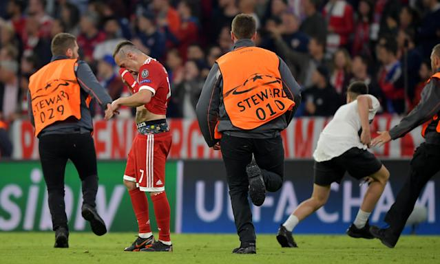 Soccer Football - Champions League Semi Final First Leg - Bayern Munich vs Real Madrid - Allianz Arena, Munich, Germany - April 25, 2018 Bayern Munich's Franck Ribery as stewards chase a pitch invader after the match REUTERS/Thorsten Wagner