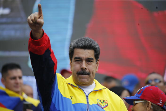 FILE - In this Aug. 10, 2019 file photo, Venezuela's President Nicolas Maduro lead a rally condemning the economic sanctions imposed by the administration of U.S. President Donald Trump on Venezuela, in Caracas, Venezuela. Maduro announced on Thursday, Aug. 29, that his delegates will start meeting again with the opposition to restart negotiations. (AP Photo/Ariana Cubillos, File)