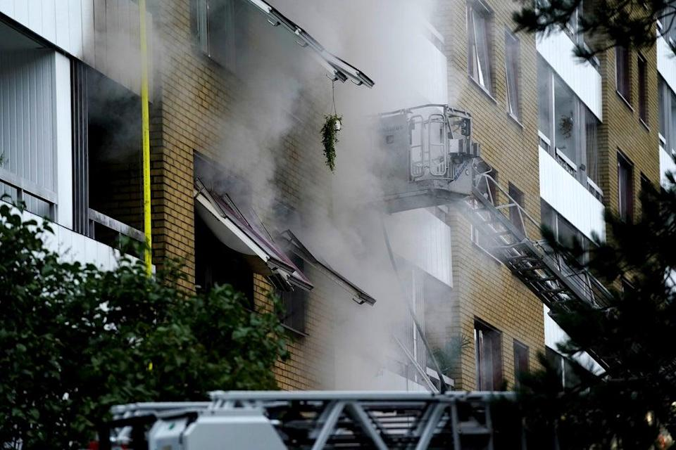 Smoke billows from an apartment building after an explosion in Annedal, central Gothenburg (AP)