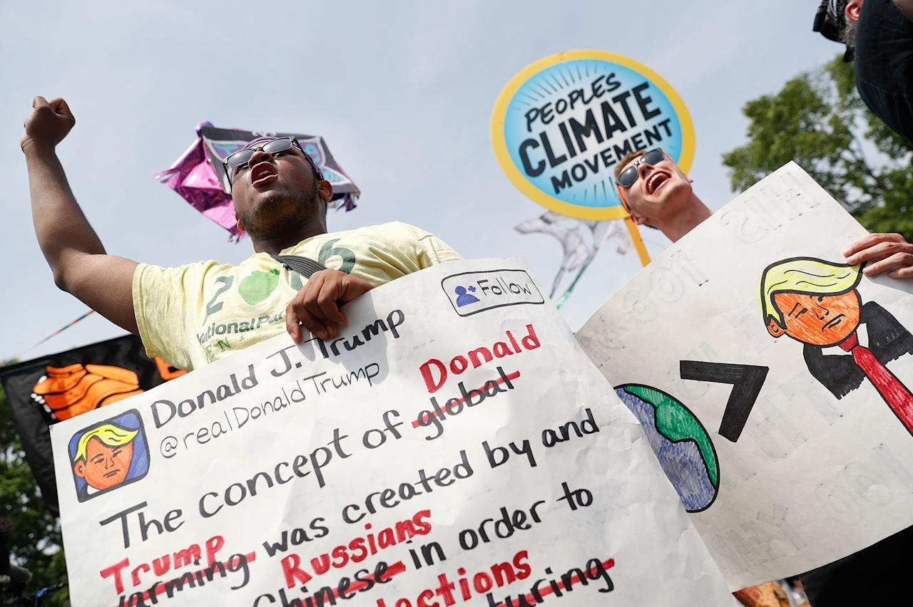 <p>A pair of participants chant in front of the White House in Washington, Saturday, April 29, 2017, during a demonstration and march. Thousands of people gathered across the country to march in protest of President Donald Trump's environmental policies, which have included rolling back restrictions on mining, oil drilling and greenhouse gas emissions at coal-fired power plants. The demonstrators sat down for 100 seconds to mark President Trump's first 100 days in office. (AP Photo/Pablo Martinez Monsivais) </p>