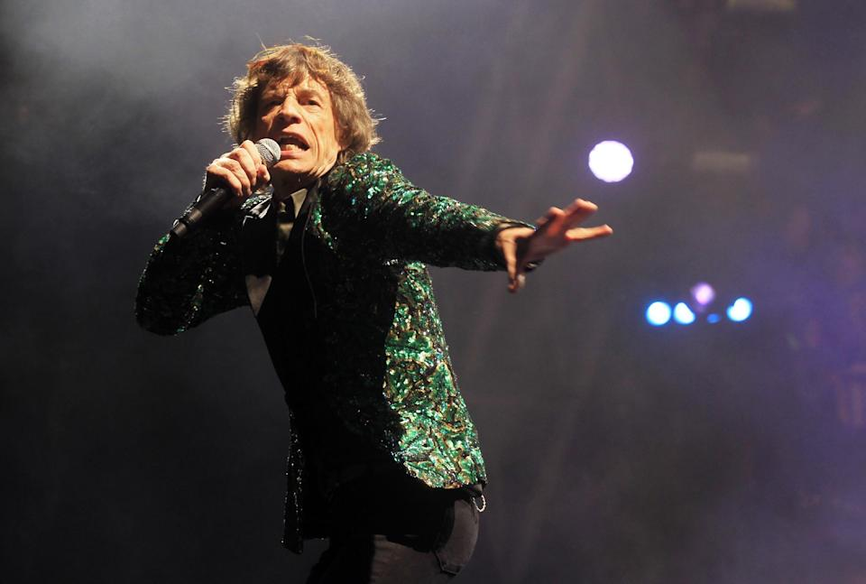 Mick Jagger of The Rolling Stones performs at Glastonbury, England on Saturday, June 29, 2013. Thousands are to enjoy the three day festival that started on Friday, June 28, 2013 with headliners Arctic Monkeys, the Rolling Stones and Mumford and Sons. (Photo by Jim Ross/Invision/AP)