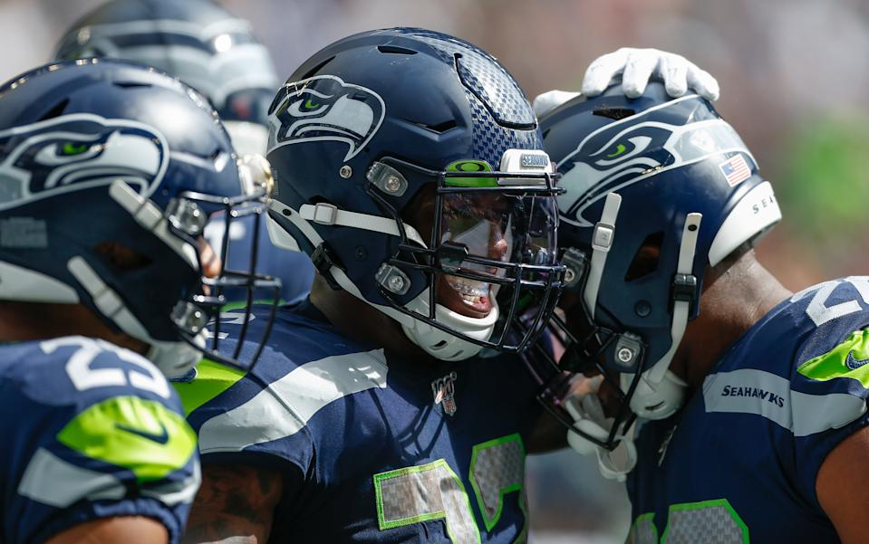 Running back Chris Carson #32 (middle) of the Seattle Seahawks celebrates after scoring a touchdown against the Cincinnati Bengals at CenturyLink Field on September 8, 2019 in Seattle, Washington. (Photo by Otto Greule Jr/Getty Images)