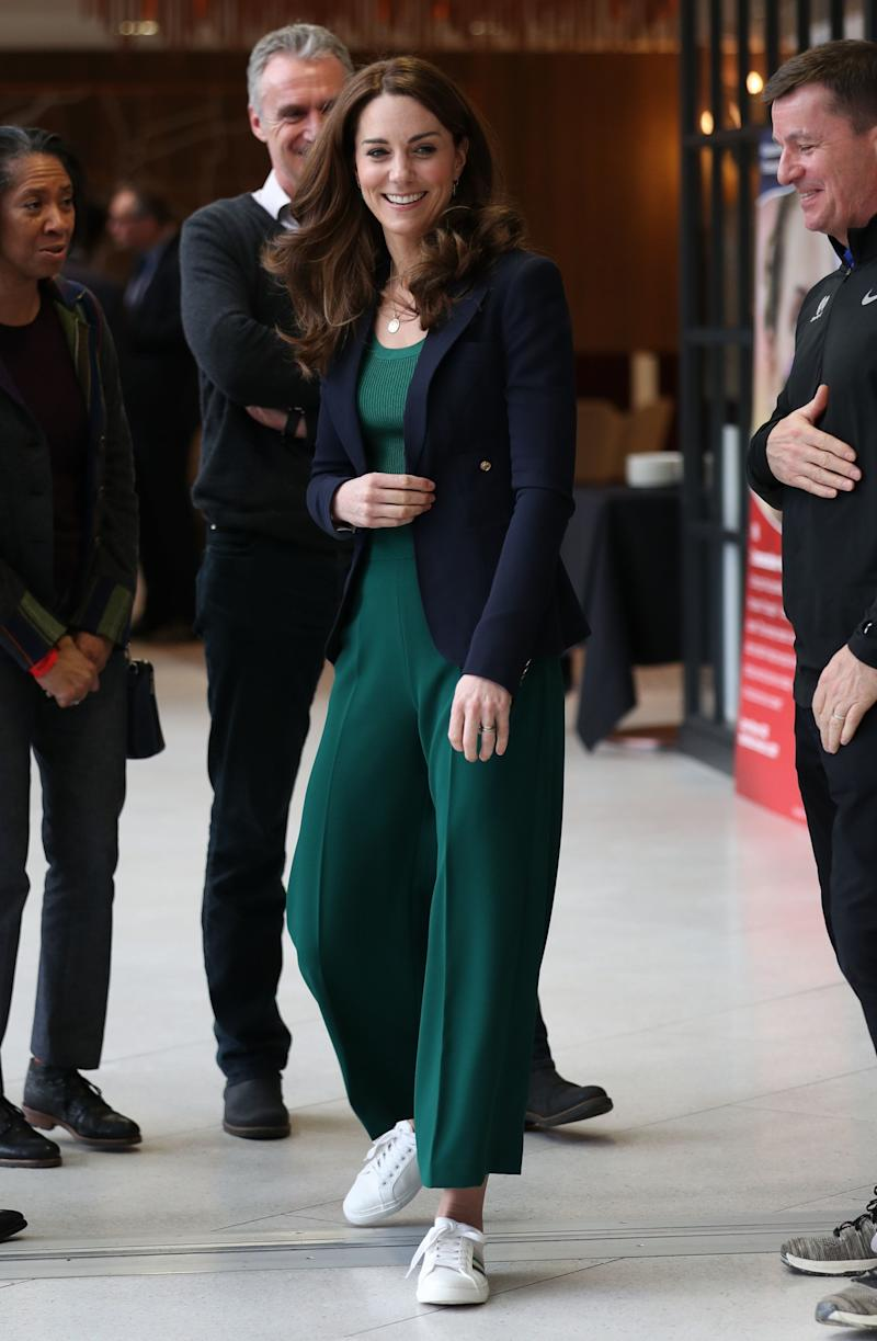 The Duchess of Cambridge looks polished in a Smythe blazer, white Marks & Spencer trainers, Zara culottes, and matching rib-knit sweater from Mango.