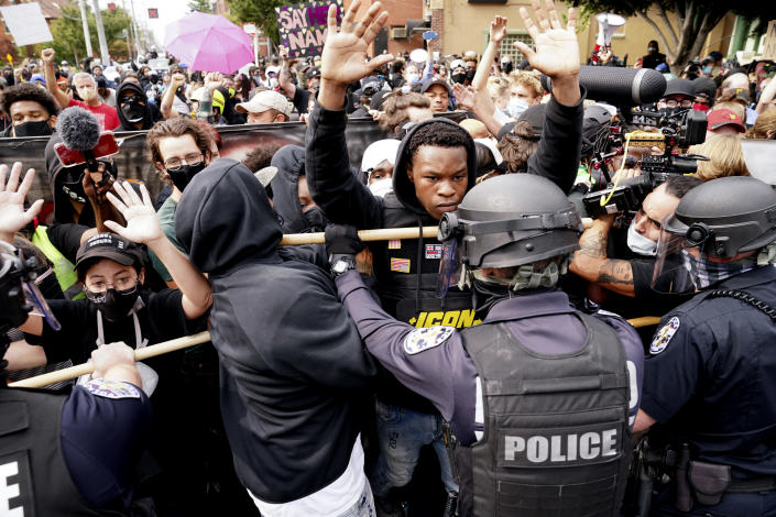 Police and protesters converge during a demonstration in Louisville. (John Minchillo/AP)