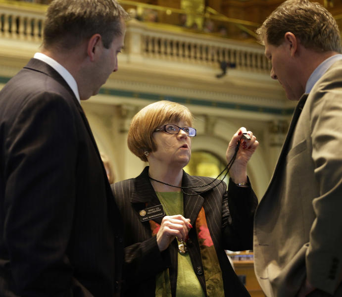 Rep. Dickey Lee Hullingworst, center, D-Boulder, shows House Minority Leader Mark Waller, left, R-Colorado Springs and Rep. Brian DelGrosso, R-Loveland, her whistle as the debate over gun control bills goes on at the Capitol in Denver on Friday, Feb. 15, 2013. (AP Photo/Ed Andrieski)