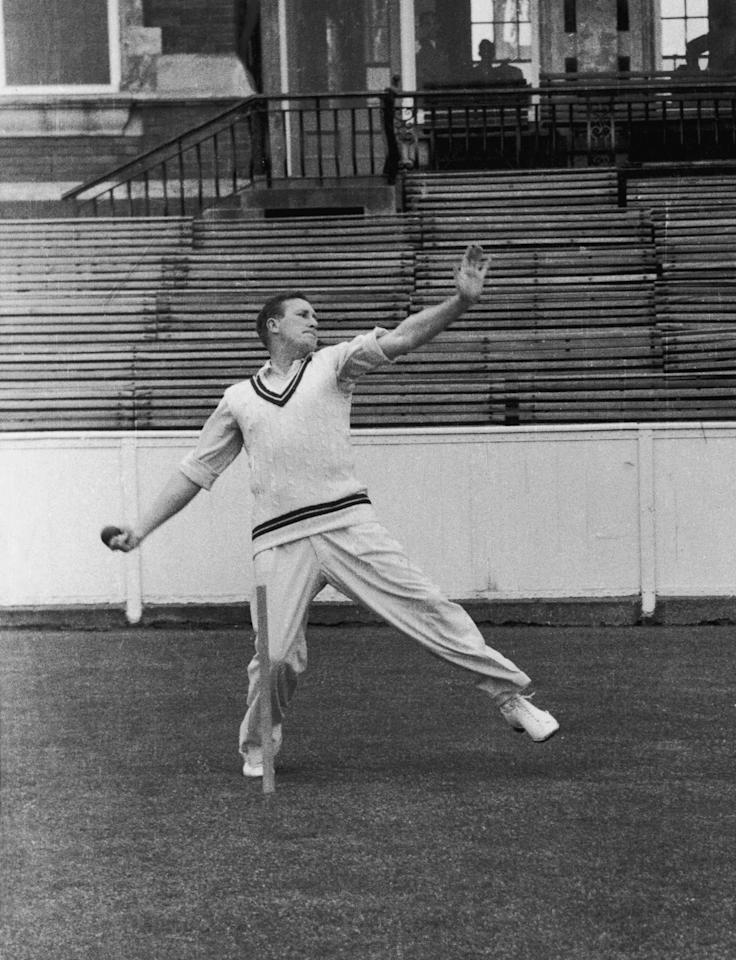 English cricketer Jim Laker (1922 - 1986) of Surrey C.C.C. bowling, 1956. (Photo by Hulton Archive/Getty Images)