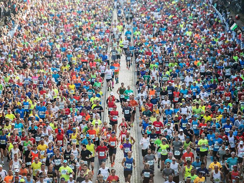 Crowd-sourcing: mixing the novelty of a city-break with the rigours of marathons such as last year's in Berlin can prove somewhat addictive: Getty