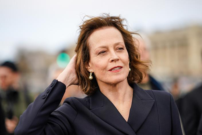 PARIS, FRANCE - FEBRUARY 25: Sigourney Weaver wears earrings, a blazer jacket, outside Dior, during Paris Fashion Week - Womenswear Fall/Winter 2020/2021, on February 25, 2020 in Paris, France. (Photo by Edward Berthelot/Getty Images)