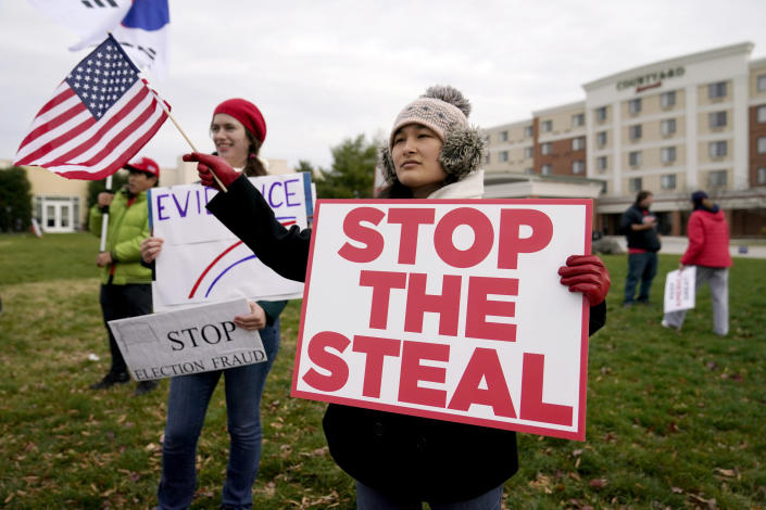 FILE - In this Wednesday, Nov. 25, 2020 file photo, Supporters of President Donald Trump gather outside of the Wyndham Hotel where the Pennsylvania State Senate Majority Policy Committee is scheduled to meet in Gettysburg, Pa. Election officials and experts are raising alarms about the private fundraising surrounding efforts to expand Republican ballot reviews to more states former President Donald Trump falsely claims he won. While some fundraising details have come to light, information about who is donating the money and how it's being spent is largely exempt from public disclosure. (AP Photo/Julio Cortez, File)