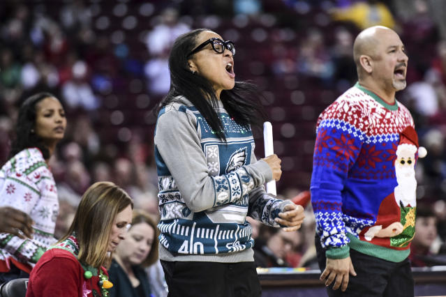 South Carolina coach Dawn Staley, center, reacts to a South Dakota basket during the first half of an NCAA college basketball game Sunday, Dec. 22, 2019, in Columbia, S.C. (AP Photo/Sean Rayford)