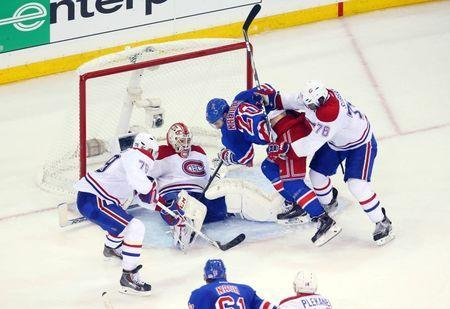 May 22, 2014; New York, NY, USA; New York Rangers left wing Chris Kreider (20) tries to get to the puck against Montreal Canadiens goalie Dustin Tokarski (middle) , defenseman Andrei Markov (79) and defenseman P.K. Subban (76) during the third period in game three of the Eastern Conference Final of the 2014 Stanley Cup Playoffs at Madison Square Garden. Ed Mulholland-USA TODAY Sports