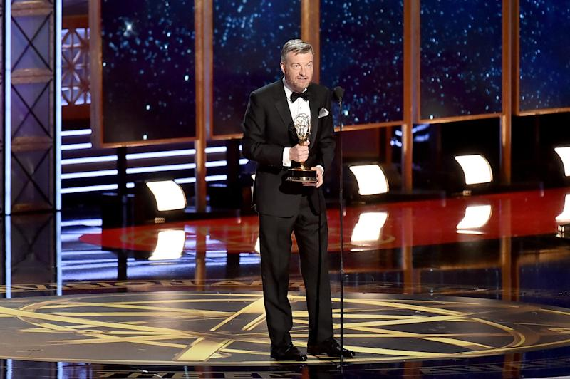 Charlie Brooker accepts the Outstanding Writing for a Limited Series, Movie, or Dramatic Special award at the 69th Annual Primetime Emmy Awards. (Jeff Kravitz via Getty Images)
