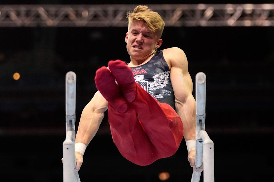 Shane Wiskus competes on the parallel bars Saturday during the men's U.S. Olympic gymnastics trials.