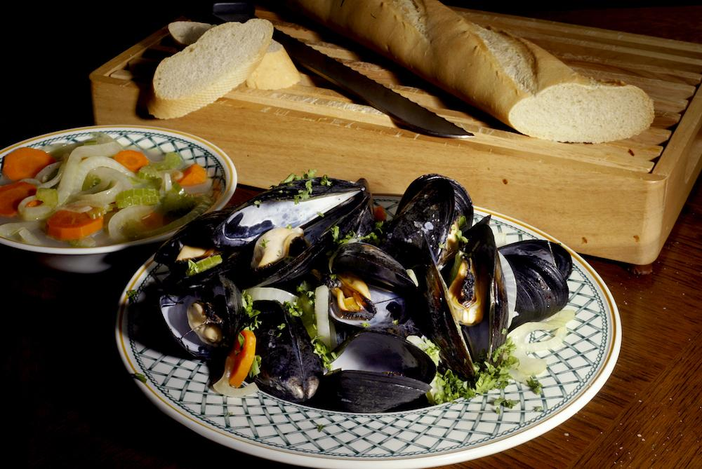 <p>Okay, so moules mariniere is the first dish that springs to mind but really you can chuck white wine into all sorts of shellfish dishes and it'll work pretty well. Plus, it's great to drink with them too so you won't go wasting a bottle. [Photo: Getty] </p>