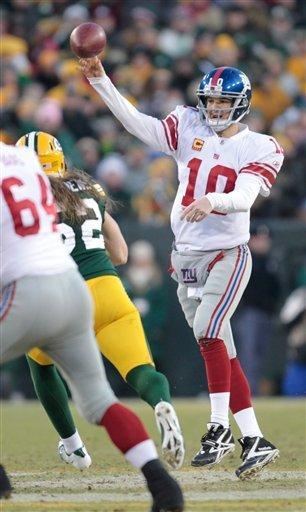 New York Giants quarterback Eli Manning throws a pass during the first half of an NFL divisional playoff football game against the Green Bay Packers Sunday, Jan. 15, 2012, in Green Bay, Wis. (AP Photo/Mike Roemer)