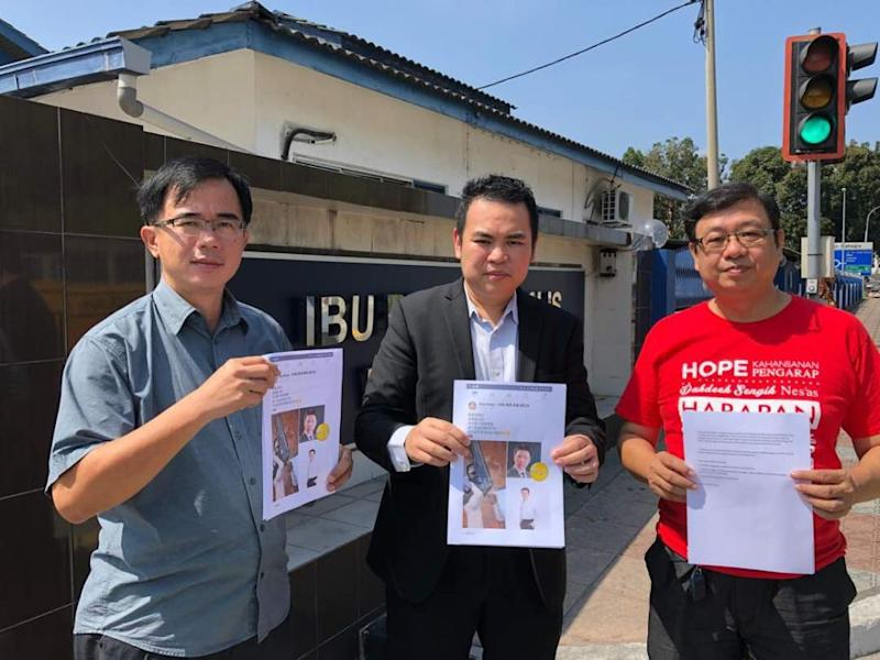 Keranji assemblyman Chong Zhemin (centre), flanked by Perak DAP executive secretary Siew Lee Wah (right) and special assistant to Kepayang assemblyman Wong Hon Long (left) outside the Ipoh district police station in Perak July 20, 2018. ― Pictures courtesy of Chong Zhemin