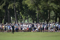 Spectators watch as Keegan Bradley hits from the 16th fairway during the final round of the Valspar Championship golf tournament, Sunday, May 2, 2021, in Palm Harbor, Fla. (AP Photo/Phelan M. Ebenhack)