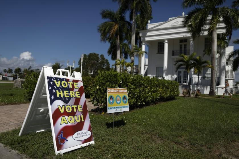 A man walks into City Hall, where early voting was in process, in Everglades City, Fla., Oct. 29