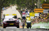 Netherland's Bauke Mollema crosses the finish line to win the fourteenth stage of the Tour de France cycling race over 183.7 kilometers (114.1 miles) with start in Carcassonne and finish in Quillan, France, Saturday, July 10, 2021. (AP Photo/Daniel Cole)