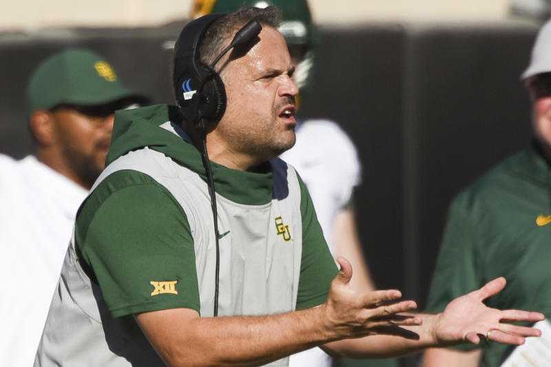FILE - In this Oct. 19, 2019, file photo, Baylor head coach Matt Rhule gestures to an official during the first half of an NCAA college football game against Oklahoma State, in Stillwater, Okla. Baylor coach Matt Rhule and Oklahoma's Lincoln Riley took over their teams under drastically different circumstances. Now they will coach against each other in the Big 12 championship game. (AP Photo/Brody Schmidt, File)