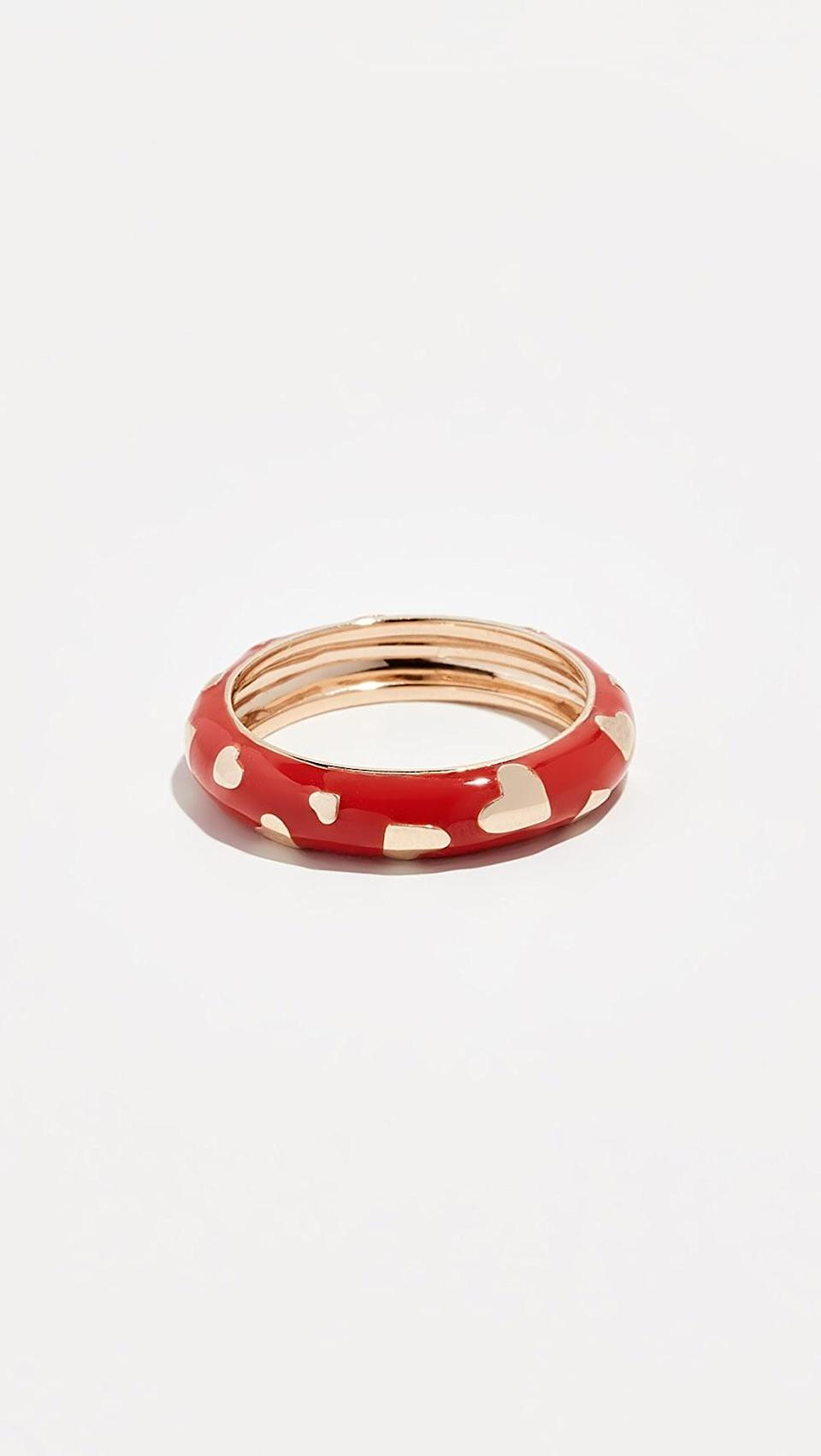 <p>This <span>Alison Lou 14k Amour Band Ring</span> ($935) is a unique take on heart jewelry, and we love it.</p>