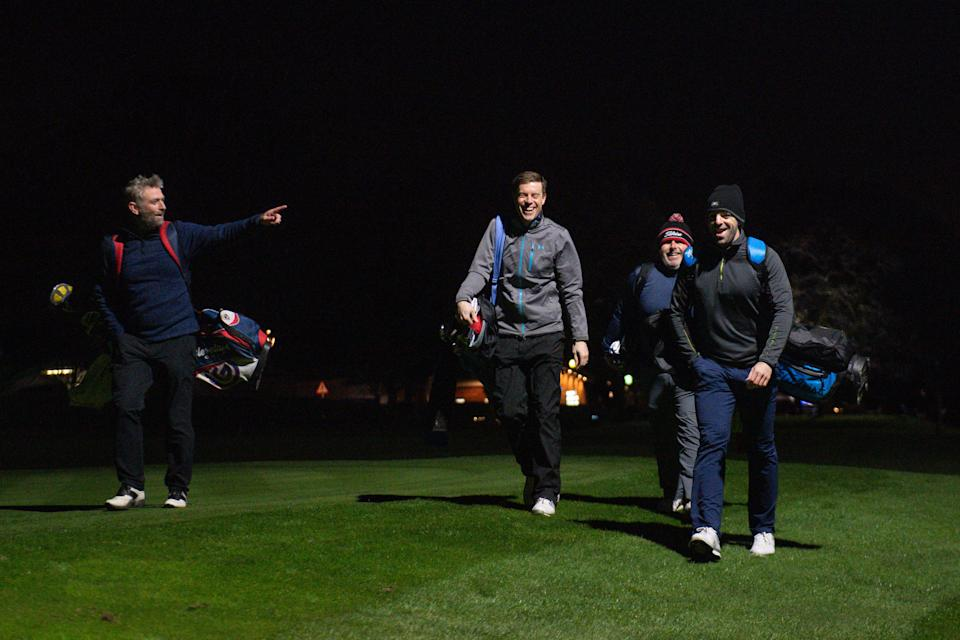 A group of golfers under floodlights at Morley Hayes Golf centre in Ilkeston, Derbyshire. The club is believed to be the first to reopen, with the first tee times at 0001, following the easing of England's lockdown restrictions to allow greater freedom outdoors. Picture date: Monday March 29, 2021.