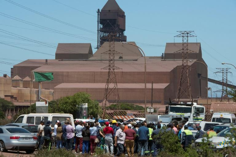 Workers protest outside the Arcellor Mittal Saldanha steel plant against the planned closure of the operation which would result in 900 jobs lost