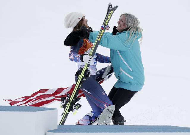United States' bronze medal winner in the women's supercombined Julia Mancuso embraces her sister Sara after a flower ceremony at the Alpine ski venue in the Sochi 2014 Winter Olympics, Monday, Feb. 10, 2014, in Krasnaya Polyana, Russia. (AP Photo/Christophe Ena)