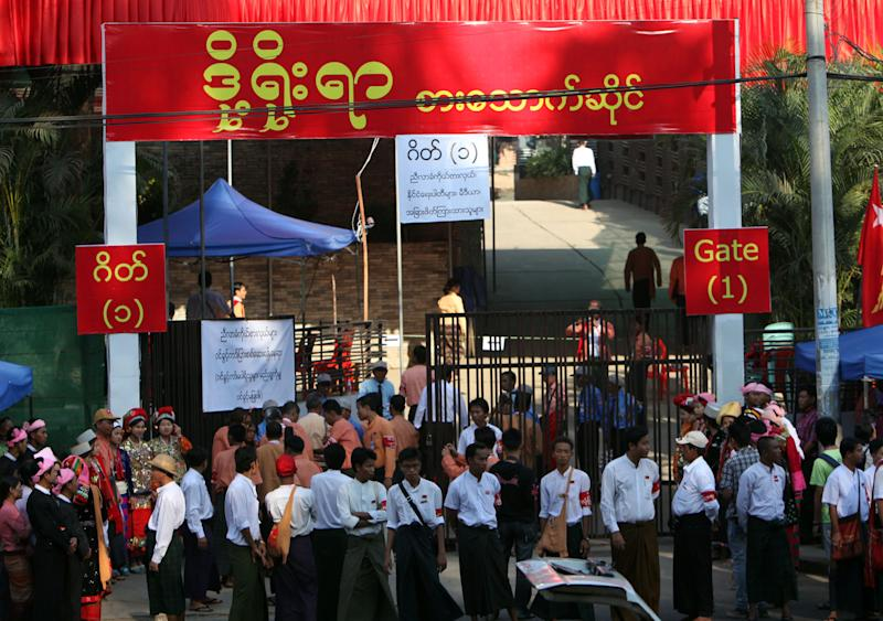 Members of Myanmar opposition leader Aung San Suu Kyi's National League for Democracy (NLD) party gather outside a venue for their first ever congress of the party at Royal Rose restaurant in Yangon, Myanmar, Saturday, March. 9, 2013. The NLD is holding an all-party congress to elect its own leadership for the first time in the group's 25-year history— an important step toward making it more reflective of its democratic ideals. It is a sign of how far Myanmar has come with political reform that the gathering is allowed at all. But it's also a test for the NLD, which is working to transform itself from a party of one into a structurally viable political opposition in time for national elections in 2015. (AP Photo/Khin Maung Win)