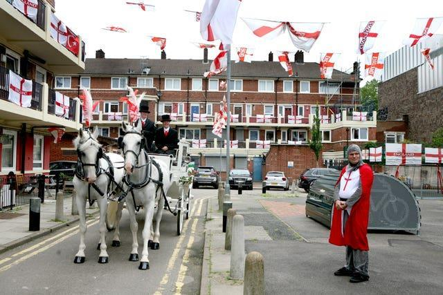Alan Putman, in costume and a horse drawn carriage, on the Kirby Estate in Bermondsey