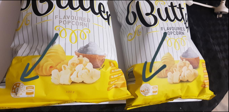 Pictured are the two Buttered Flavoured Popcorn packets from Aldi which have two different Health Star Ratings.